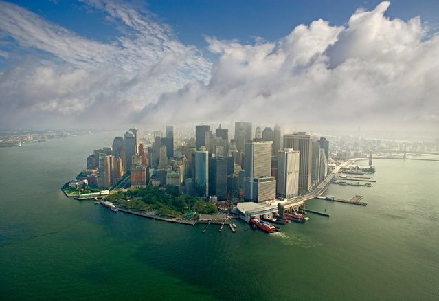 These are the stunning panoramic shots of some of the worlds most beautiful locations. Company AirPano travel the world photographing its wonders from above. Their shots include famous cities – such as New York, Paris and Barcelona – as well as natural marvels, like volcanoes and waterfalls. Here: Downtown Manhattan, New York. (Photo by Airpano/Caters News)