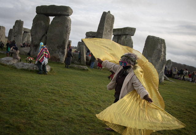 Druids, pagans and revellers gather at Stonehenge, hoping to see the sun rise, as they take part in a winter solstice ceremony at the ancient neolithic monument of Stonehenge near Amesbury on December 21, 2016 in Wiltshire, England. (Photo by Matt Cardy/Getty Images)