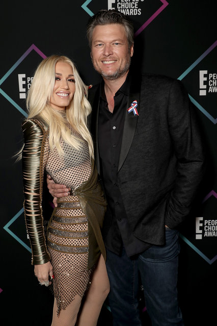 Gwen Stefani and Blake Shelton backstage during the 2018 E! People's Choice Awards held at the Barker Hangar on November 11, 2018. (Photo by Todd Williamson/E! Entertainment)