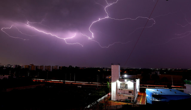 """Lightning illuminates the sky during a thunderstorm in Bhopal, India, 19 March 2021. The India Meteorological Department (IMD) in its """"All India Weather Forecast Bulletin"""" for 19 March reported that it observed thundershowers and rain througout the day in many regions of the country. (Photo by Sanjeev Gupta/EPA/EFE)"""