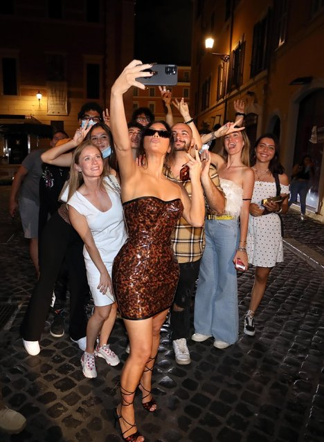 Ciao Bella! Kim Kardashian takes a night walk to the Trevi Fountain.  Kim and her team took a late-night stroll after dinner to sightsee and take photos at the iconic fountain in Rome on June 30, 2021. Kim was mobbed by fans when they recognized it was her and she happily took socially distanced photos with some of them. (Photo by Backgrid USA)