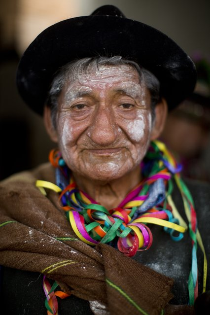 In this Sunday, March 29, 2015 photo, drummer Agripino Tanta Pareja of the Cagallo district of Ayacucho, poses for a photo during the Vencedores de Ayacucho dance festival, in the Acho bullring in Lima, Peru. There was singing in the native Quechua language during the one-day dance competition, and traditional music played on instruments including Andean pan pipes, harps and violins. (Photo by Rodrigo Abd/AP Photo)