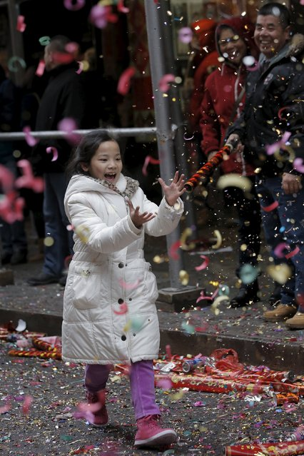 People celebrate the Chinese Lunar New Year in Manhattan's Chinatown in New York February 8, 2016. (Photo by Brendan McDermid/Reuters)
