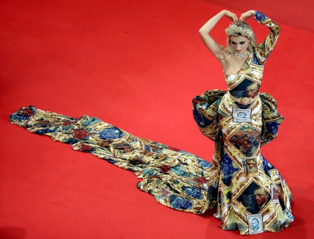 """A guest arrives for the screening of the film """"Bac Nord"""" at the 74th edition of the Cannes Film Festival in Cannes, southern France, on July 12, 2021. (Photo by Reinhard Krause/Reuters)"""