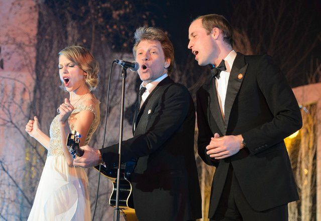 The Duke of Cambridge (right) sings with Taylor Swift (left) and Jon Bon Jovi at the Centrepoint Gala Dinner at Kensington Palace, London, on November 26, 2013. (Photo by Dominic Lipinski/PA Wire)