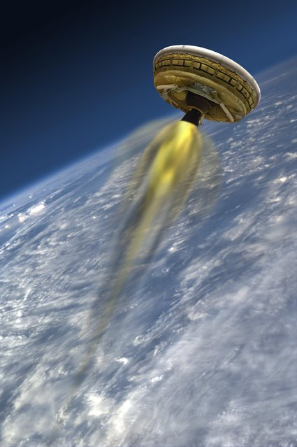 This artist's concept shows the test vehicle for NASA's Low-Density Supersonic Decelerator (LDSD), designed to test landing technologies for future Mars missions. LDSD project will be flying a rocket-powered, saucer-shaped test vehicle into near-space from the Navy's Pacific Missile Range Facility on Kauai, Hawaii, in June. (Photo by NASA)