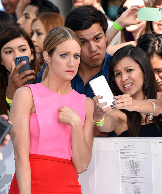 Actress Brittany Snow takes a selfie with a fan at The 2015 MTV Movie Awards at Nokia Theatre L.A. Live on April 12, 2015 in Los Angeles, California. (Photo by Jason Merritt/Getty Images)