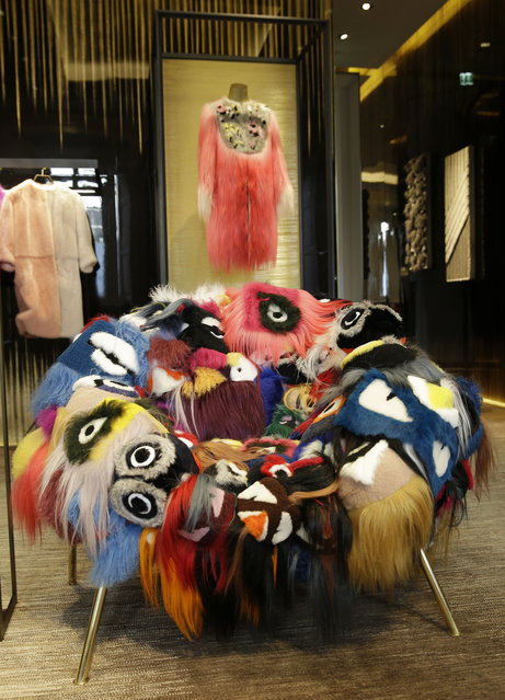 """In this picture taken on Wednesday, April 15, 2015,  a creation by Fendi, """"The Armchair of Thousand Eyes"""", is displayed at the Milan Furniture Fair, in Milan, Italy. (Photo by Antonio Calanni/AP Photo)"""