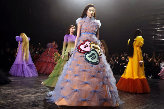 Models present creations by Viktor and Rolf during the 2019 Spring-Summer Haute Couture collection fashion show in Paris, on January 23, 2019. (Photo by Francois Guillot/AFP Photo)