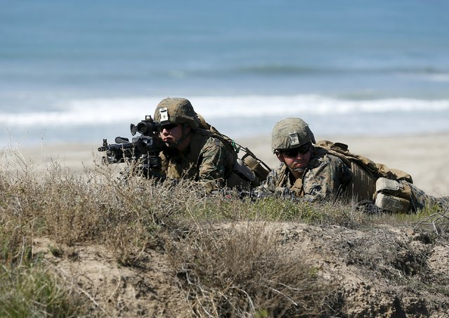 U.S. Marines take up a defensive position as they train with soldiers from Japan's Ground Self Defense Force during the bilateral annual Iron Fist military training exercise in Camp Pendleton, California February 26, 2016. (Photo by Mike Blake/Reuters)