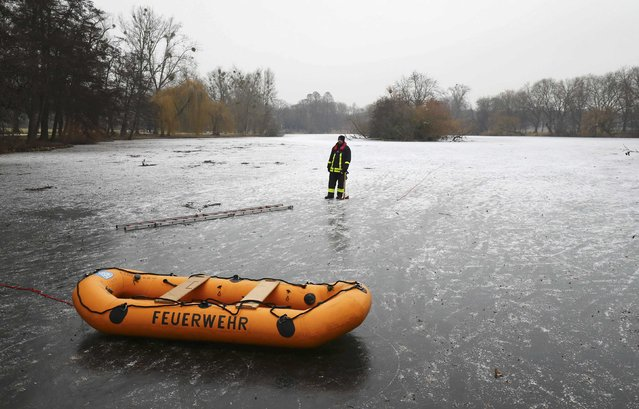 A member of Frankfurt's fire fighter water rescue brigade stands on a frozen lake during a rescue exercise in Frankfurt, Germany, January 24, 2017. (Photo by Kai Pfaffenbach/Reuters)