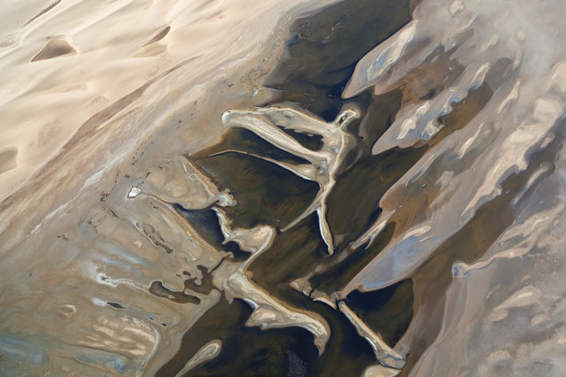 An aerial view of the Sandwich Harbour, in October, 2014, in the Namib Desert, Namibia. (Photo by Theo Allofs/Barcroft Media)