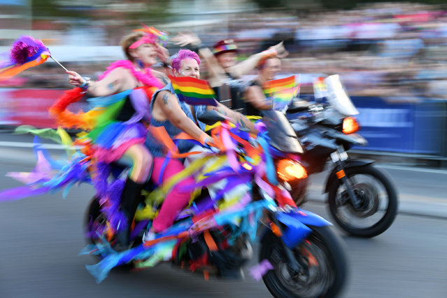 People participate in a motorcycle rally during the annual Gay and Lesbian Mardi Gras parade in Sydney on March 2, 2019. Thousands of revellers took part in the iconic festival which celebrates sexual equality in the heart of Australia's biggest city. (Photo by Saeed Khan/AFP Photo)
