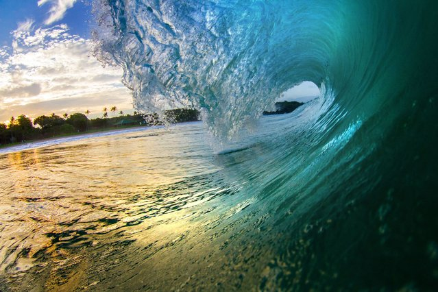 The giant waves which pounded Hawaii last week may have looked spectacular from the shoreline – but as these photographers have proved they were just as swell from the inside. (Photo by Caters News)