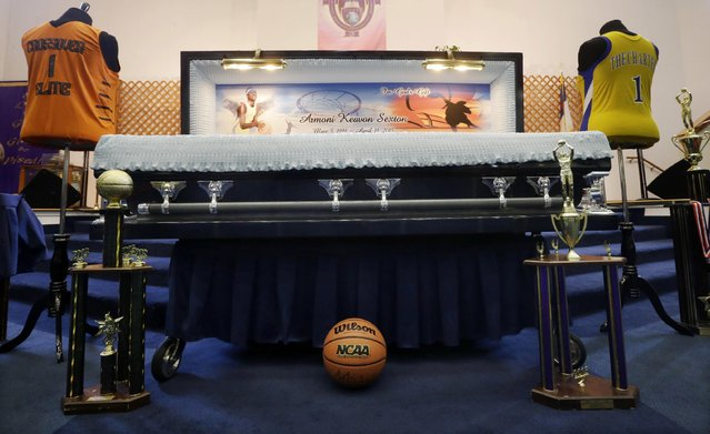 Basketball memorabilia surrounds the casket Monday, April 27, 2015, during the funeral for Armoni Keavon Sexton, a promising New Jersey high school basketball player who was killed in a drive-by shooting, in Paterson, N.J. Sexton, 15, a top scorer and rebounder at the Paterson Charter School for Science for Science and Technology, was killed and three others were injured in the shooting in Paterson on April 18. (Photo by Mel Evans/AP Photo)
