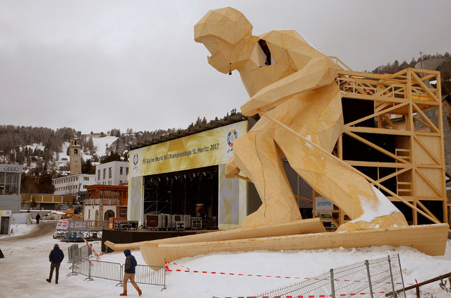A giant wooden sculpture of a ski racer is placed beside the stage for the medal ceremonies of the upcoming FIS Alpine World Ski Championships 2017 in the mountain resort of St. Moritz, Switzerland February 2, 2017. (Photo by Arnd Wiegmann/Reuters)