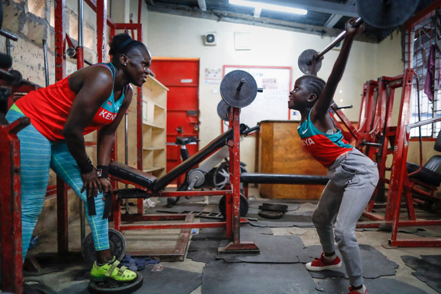 Mercy Obiero (L) watches as her daughter Channel Obiero (R) practices weightlifting in a gym in Eastleigh, Nairobi, Kenya, 06 March 2019. Forty-year-old Obiero, known as Kenya's strongest woman, started weightlifting in 1999 by following her brother's footstep. She has represented her country in a number of international competitions including 2012 London Olympics, 2015 All-Africa Games in which she won a bronze medal, and 2016 African Weightlifting Championships where she brought home a silver medal from. Obiero is now using her experience as an athelete to train young girls, including her two daughters Channel and Natasha, in an effort to promote the sport and develop the next generation of competitors in the East African country. (Photo by Dai Kurokawa/EPA/EFE)