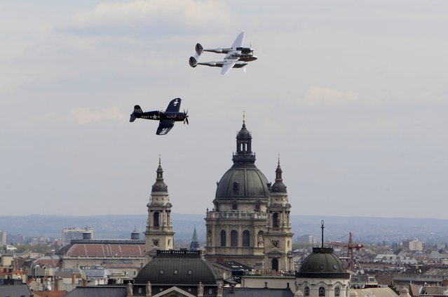 A F4U Corsair airplane and a P-38 Lightning airplane (R) perform during an air show in Budapest, Hungary on May 1, 2015. (Photo by Bernadett Szabo/Reuters)