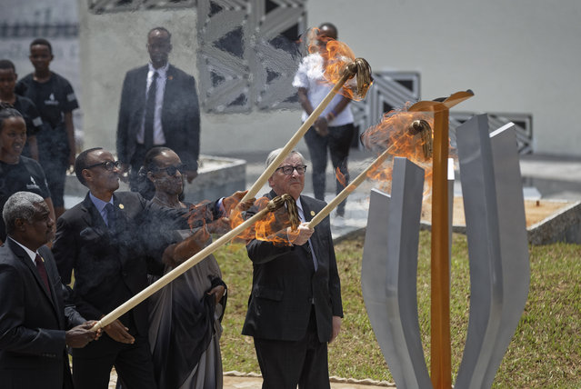 From left to right, Chairperson of the African Union Commission Moussa Faki Mahamat, Rwanda's President Paul Kagame, Rwanda's First Lady Jeannette Kagame, and President of the European Commission Jean-Claude Juncker, light the flame of remembrance at the Kigali Genocide Memorial in Kigali, Rwanda, Sunday, April 7, 2019.  Rwanda is commemorating the 25th anniversary of when the country descended into an orgy of violence in which some 800,000 Tutsis and moderate Hutus were massacred by the majority Hutu population over a 100-day period in what was the worst genocide in recent history. (Photo by Ben Curtis/AP Photo)