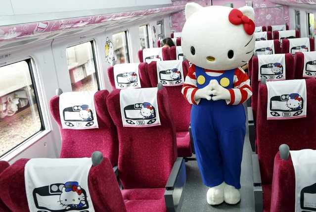 A performer dressed as a Hello Kitty poses inside a Hello Kitty-themed Taroko Express train in Taipei, Taiwan March 21, 2016. (Photo by Tyrone Siu/Reuters)