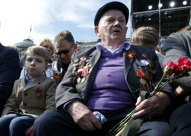 A World War Two veteran (R) waits before watching the Victory Day parade at Red Square in Moscow, Russia, May 9, 2015. (Photo by Grigory Dukor/Reuters)