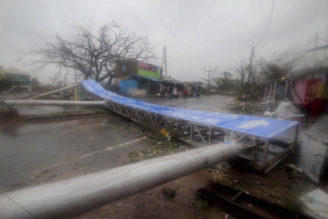 Damaged signage lies on a street in Puri district after Cyclone Fani hit the coastal eastern state of Odisha, India, Friday, May 3, 2019. Cyclone Fani tore through India's eastern coast on Friday as a grade 5 storm, lashing beaches with rain and winds gusting up to 205 kilometers (127 miles) per hour and affecting weather as far away as Mount Everest as it approached the former imperial capital of Kolkata. (Photo by AP Photo/Stringer)
