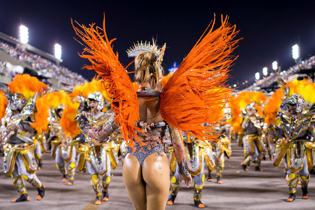 "Members of Unidos da Tijuca Samba School during their parade at 2014 Brazilian Carnival at Sapucai Sambadrome on March 03, 2014 in Rio de Janeiro, Brazil. Rio's two nights of Carnival parades began on March 2 in a burst of fireworks and to the cheers of thousands of tourists and locals who have previously enjoyed street celebrations (known as ""blocos de rua"") all around the city. (Photo by Buda Mendes/Getty Images)"