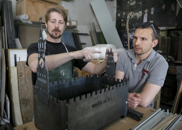 Ukrainian artists assemble a barbecue grill in the shape of Moscow's Kremlin at their workshop in Kiev May 14, 2015. (Photo by Gleb Garanich/Reuters)