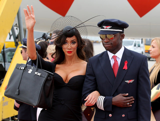 US model Yasmine Petty, left, arrives for the largest annual AIDS charity gala in Europe known as the Life Ball,  at the Vienna International Airport near Schwechat, Austria, Friday, May 15, 2015. (Photo by Ronald Zak/AP Photo)