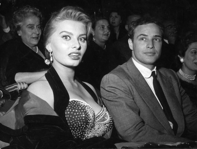 "Italian actress Sophia Loren and US actor Marlon Brando at a cinema in Rome on November 11, 1954, where Brando received the Francesco Pasinetti Prize for his performance in the film ""On The Waterfront"". (Photo by Keystone/Getty Images)"