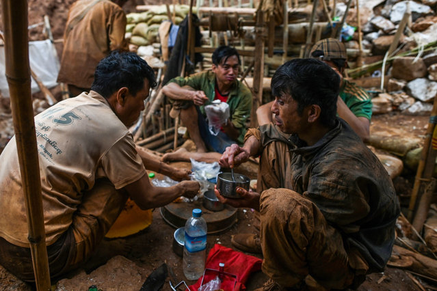 This photo taken on May 16, 2019 shows miners eating at a ruby mine in Mogok, north of Mandalay. (Photo by Ye Aung Thu/AFP Photo)