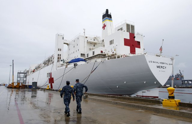 Naval personnel walk past the hospital ship USNS Mercy (T-AH 19) prior to its departure from Naval Base San Diego on a four month Pacific Partnership humanitarian deployment to the South Pacific May 15, 2015. The ship has a 1,000 patient bed capacity, four X-ray rooms a CT scan unit as well as a optometry and lens laboratory. (Photo by Mike Blake/Reuters)