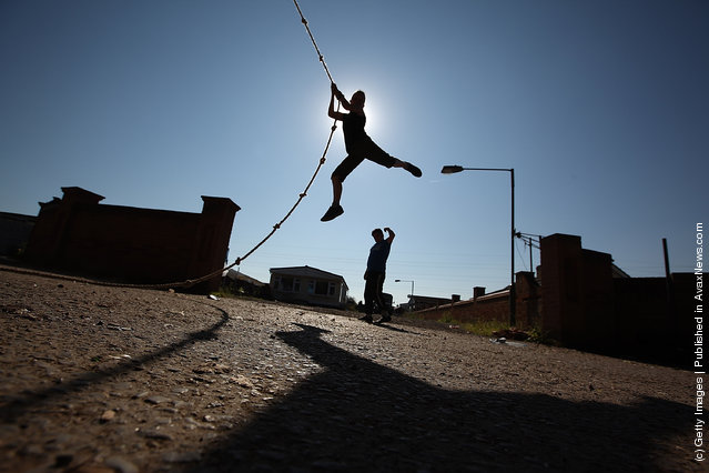 A traveller youth plays on a rope at Dale Farm travellers camp