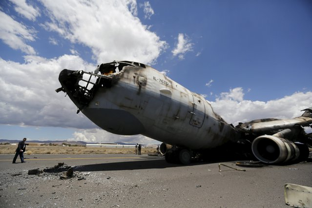 The wreckage of a Yemeni air force military transport aircraft is seen on the tarmac after the aircraft was destroyed by an air strike, at the international airport of Yemen's capital Sanaa, May 5, 2015. (Photo by Khaled Abdullah/Reuters)
