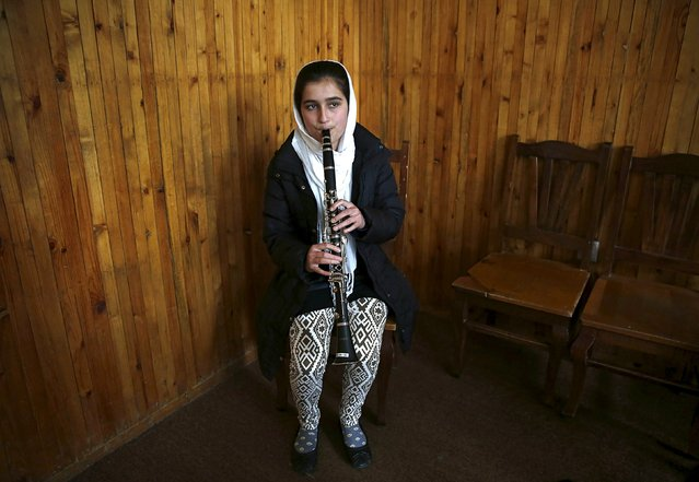 Sahar Malikzai, a member of the Zohra orchestra, an ensemble of 35 women, practises at Afghanistan's National Institute of Music, in Kabul, Afghanistan April 9, 2016. (Photo by Ahmad Masood/Reuters)