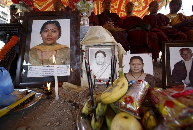 Offerings are seen in front of portraits of earthquake victims during the first anniversary of the earthquake in Kathmandu, Nepal, April 24, 2016. (Photo by Navesh Chitrakar/Reuters)