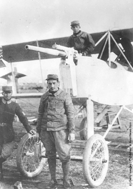 1915:  Greek airmen stand with a Voisin plane, armed with a cannon