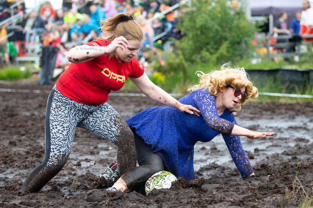 Players in action during the Swamp Soccer Championships 2019 in Hyrynsalmi, Finland, 19 July 2019. The World Championship in swamp football is played annually on Vuorisuo bog in Hyrynsalmi. (Photo by Tomi Hanninen/EPA/EFE)