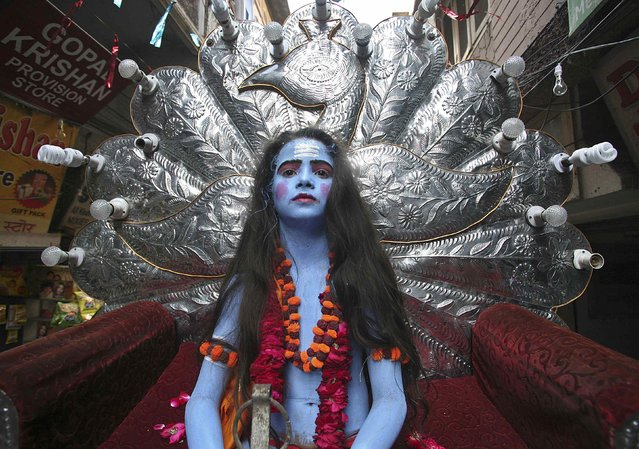 A boy takes part in a religious procession on the occasion of Ramnavmi festival in the northern Indian city of Amritsar April 8, 2014. The festival commemorates the birth of Hindu god Rama. (Photo by Munish Sharma/Reuters)