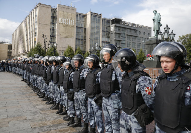 Police block a square during an unsanctioned rally in the center of Moscow, Russia, Saturday, August 3, 2019. Moscow police on Saturday detained nearly 90 people protesting the exclusion of some independent and opposition candidates from the city council ballot, a monitoring group said, a week after arresting nearly 1,400 at a similar protest. (Photo by Alexander Zemlianichenko/AP Photo)