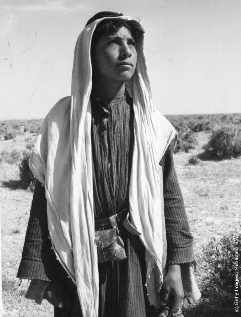 1955:  A Bedouin boy (Arab., Badawi, 'dwellers in the desert') are nomadic Arabs