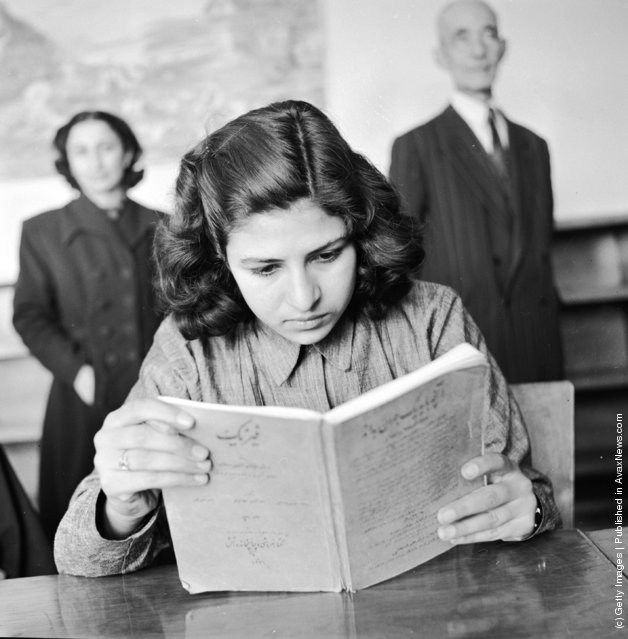 1952:  A girl student at a vocational training school for seamstresses studies the theoretical aspects of her work. This is one of the first schools for girls founded by the government in Teheran