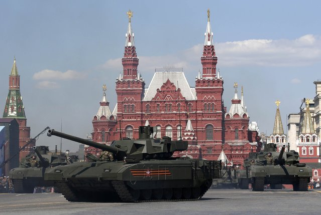 Russian servicemen stand atop T-14 tanks with the Armata Universal Combat Platform during the Victory Day parade, marking the 71st anniversary of the victory over Nazi Germany in World War Two, at Red Square in Moscow, Russia, May 9, 2016. (Photo by Sergei Karpukhin/Reuters)