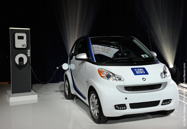An electric car2go Smart vehicle from the company's carsharing network is displayed before a keynote address by Chairman of the Board of Management of Daimler AG and head of Mercedes-Benz Cars Dr. Dieter Zetsche at the 2012 International Consumer Electronics Show