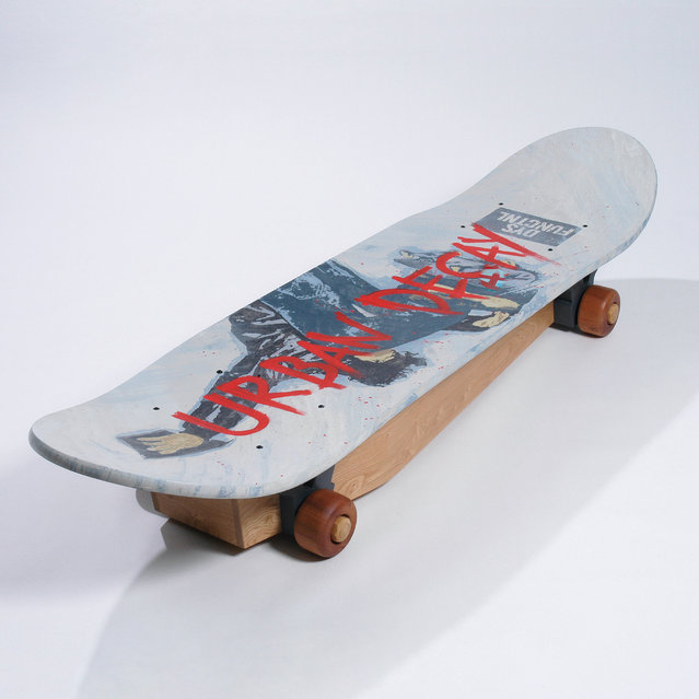 A coffin in the shape of a skateboard. (Photo by Caters News Agency)