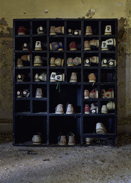 "A rack of bowling shoes in a old asylum, New York. ""The bowling shoe rack, complete with all the forgotten shoes, was incredible to photograph"". (Photo by Daniel Barter/Caters News)"