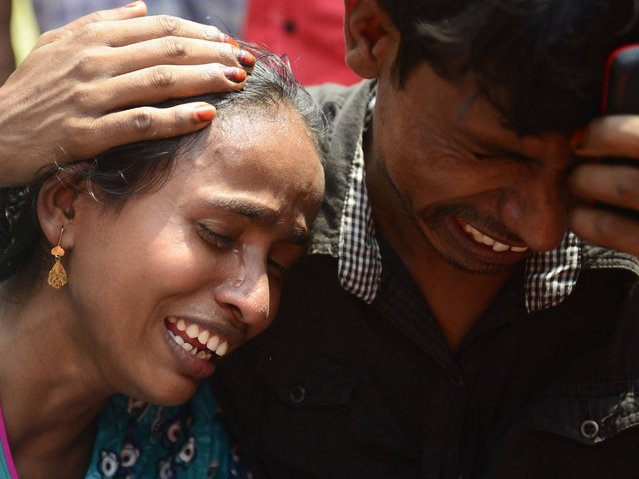 Bangladeshi relatives mourn the victims of a ferry capsize on the river Meghna in Munshiganj district, the exact number of passengers was not immediately known. It is common for ferries to carry many more than their official limit. (Photo by Munir Uz Zaman/AFP Photo)