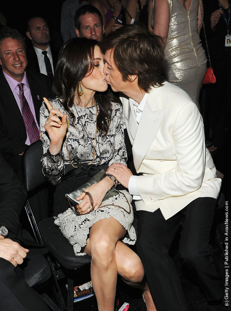 Sir Paul McCartney and Nancy Shevell kiss in the audience at the 54th Annual GRAMMY Awards held at Staples Center