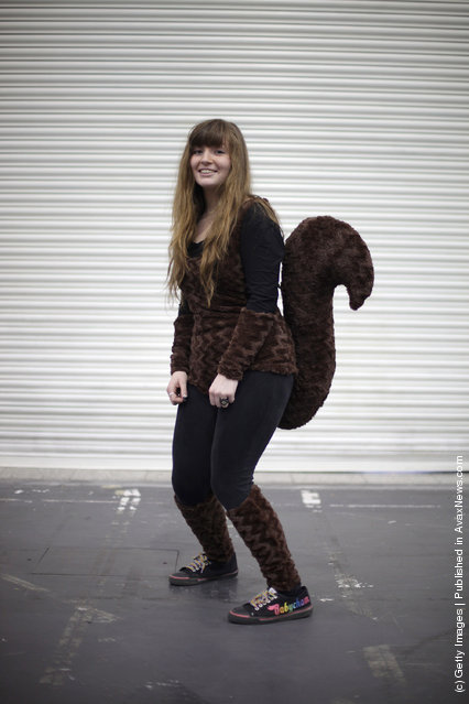 A visitor to the London Super Comic Convention wears a Squirrel Girl  costume at ExCel