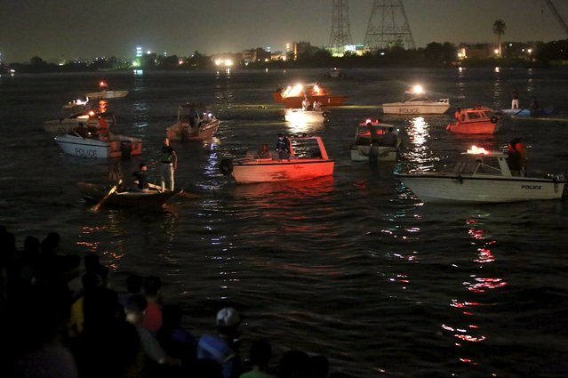 People gather along the banks of the Nile River during a search for the victims of a boat accident on the River Nile in the Warraq area of Giza, Egypt, early July 23, 2015. At least 15 people drowned when the small boat collided with a barge and capsized on the Nile River near Cairo on Wednesday night, Egypt's interior ministry said in a statement. (Photo by Mohamed Abd El Ghany/Reuters)